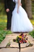 Beautiful floral wedding  bouquet on wooden bridge — Stock Photo