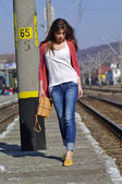 Young beautiful woman walking on trainstation — Stock Photo