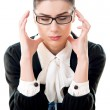 Stressed businesswoman with headache — Stock Photo