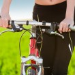 Close up of woman hands resting on bike — Stock Photo