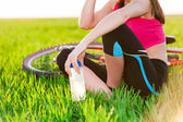Close up of attractive young active woman and bike — Stock Photo