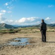 Man standing alone at muddy volcanoes — Stock Photo #45563117