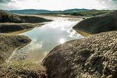 Rain water reservoir over muddy volcanoes — Stock Photo
