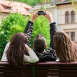 Three friends hanging out in the park and taking pictures of themselves — Stock Photo #46076047