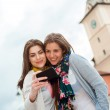 Two young women traveling and having selfies — Stock Photo