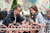 Couple enjoying a drink at restaurant — Stock Photo