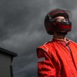 Постер, плакат: Race car driver wearing protective helmet