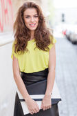 City chic girl with neon blouse — Stock Photo