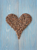 Cacao nibs shaped in a heart symbol — Stock Photo