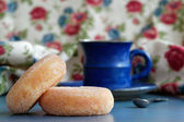 Donuts with blue coffee cup — Photo