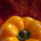 Yellow Pepper on Red — Stock Photo