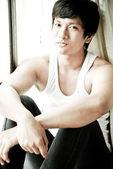 Asian man in tank-top — Stock Photo