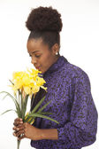 African american girl with flowers — Stock Photo
