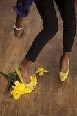 Girl stomps flowers — Stock Photo