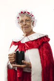 Mrs Claus isolated on white, holding a cup of hot chocolate — Стоковое фото