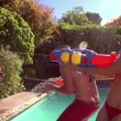 Friends playing with water guns — Stock Video #45147429