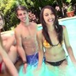 Teenager splashing water swimming pool — Stock Video #45149649