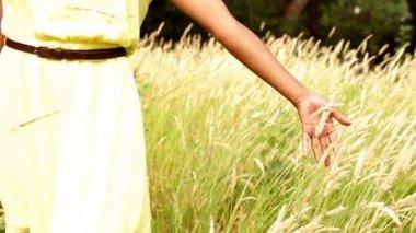 Woman walking in meadow — Stockvideo