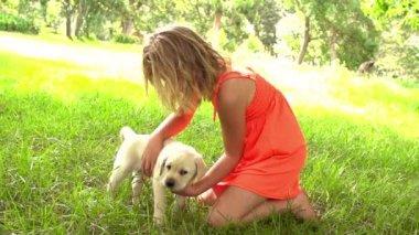 Girl petting little dog — Stock Video