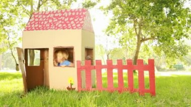 Little children sitting in playhouse — Stock Video