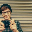 Hipster taking pictures with old vintage camera — Stock Video