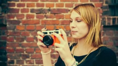 Teenage woman having fun taking pictures with old camera — Stock Video