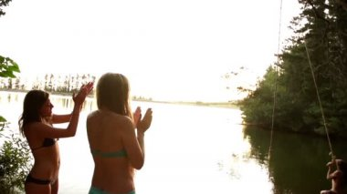 Teenager jumping into the lake — Vídeo de Stock
