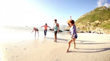 Friends spinning on the beach in slow motion — Stock Video