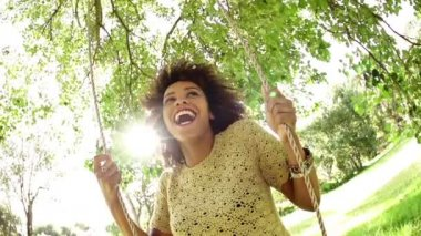African american woman on a swing — Video Stock