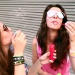 Girls with sunglasses having fun making bubbles — Stock Video #45161933
