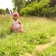 Little female baby in park crawling — Stock Video