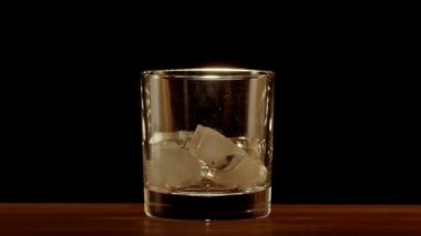Whiskey poured into glass — Vídeo stock