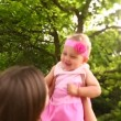 Baby girl being lifted in slow motion by her mother — Stock Video