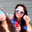 Girls with sunglasses having fun making bubbles — Stock Video #45177803