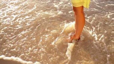 Girl is splashing water at the beach — Vídeo de Stock