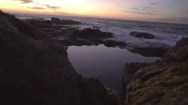 Rocky coastline during sunset — Stock Video
