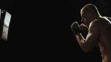 Kickboxer shadow boxing as exercise for the big fight — Stock Video