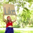 Superhero young girl holding like sign — Stock Video #45459785