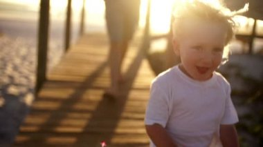 Boy is running down the jetty — Video Stock
