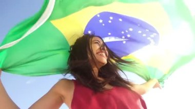 Cheerful girl from brazil with brazilian flag — Stock Video