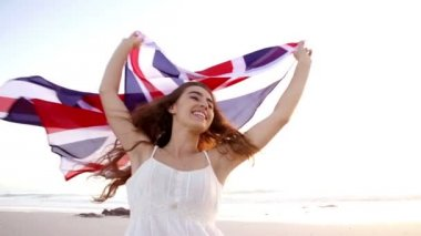 Woman running with Union Jack — Stock Video