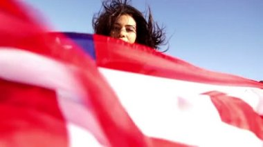 American woman with stars and stripes flag — Stock Video #45454775