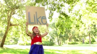 Superhero young girl holding like sign — Stock Video