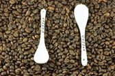 Coffee beans with a spoon — Stock Photo