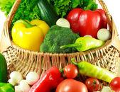 Woven basket full of fresh organic vegetables — Stock Photo