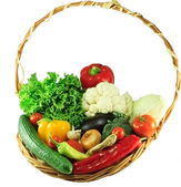 Organic vegetables in a wicker basket — Stock Photo