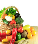 Vegetables and fruits in a wooden basket — Stockfoto