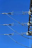 Isolatoren am Hochspannungsmast — Foto Stock
