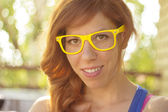 Portrait of a hipster girl with big glasses — Stock Photo