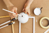 Painter painting a sphere, close-up — Stock Photo